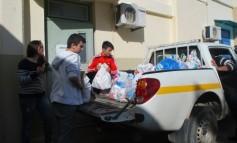 Προσφοράς τροφίμων σε απόρους από την Α΄τάξης του Γενικού Λυκείου Γουβών.