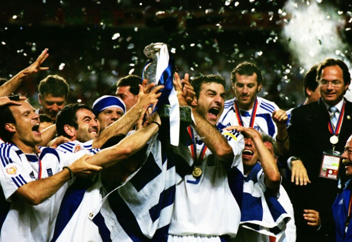 Traianos Dellas of Greece celebrates with the trophy after the final in Lisbon.