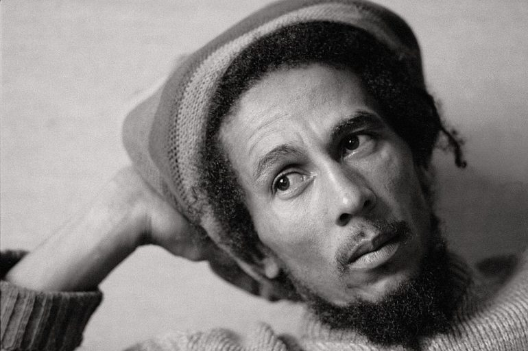 Bob Marley, singer The singer sat with a Jamaican cap