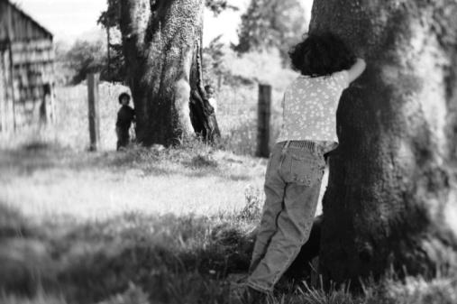 Girls playing hide and seek
